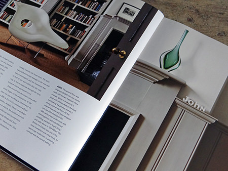 john name and green art glass on a shelf