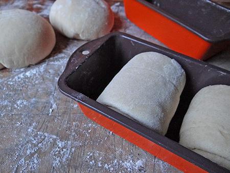 Hokkaido milk bread dough in baking tin