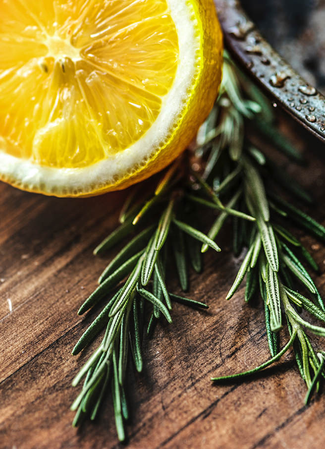 Sprig of rosemary and half a cut lemon